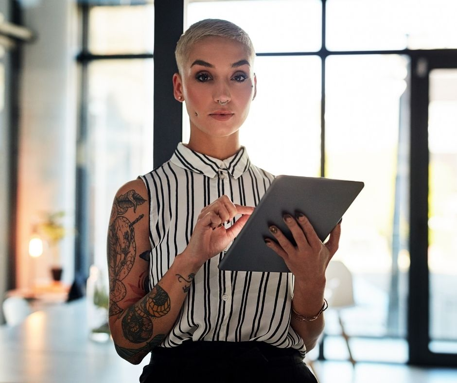 woman starting her own website on tablet device