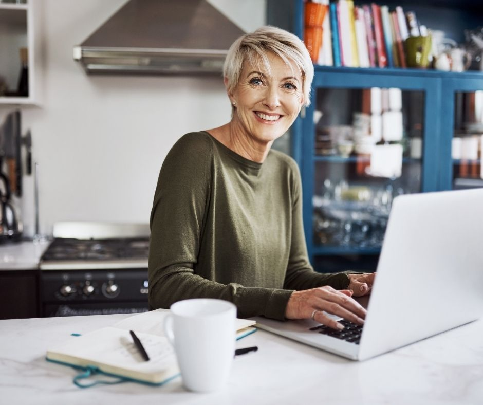 woman starting her own website on her laptop